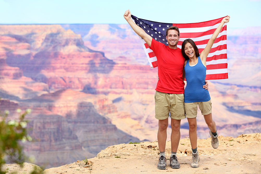 Couple wave American flag at Grand Canyon to celebrate the Powerball record jackpot